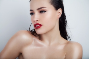 beautiful woman portrait with stylish makeup and glowing skin, studio white